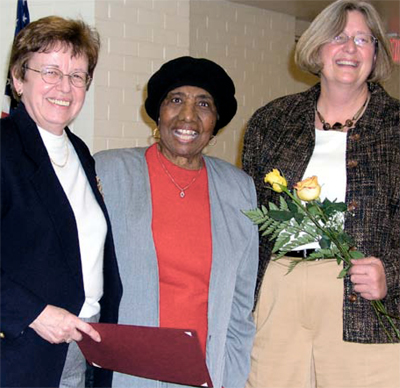 Helen M. Alexander receiving her 30 year Zonta Meritorious Service Award from sister Zontians Jacqueline M. Beaudry and Sandra Miller