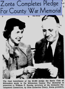 Cleary with check for War Memorial photo